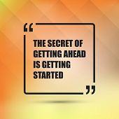 Постер, плакат: The Secret Of Getting Ahead is Getting Started Inspirational Quote Slogan Saying on an Abstract