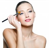 Woman Applying Eyeshadow With Brush