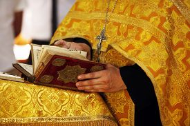 image of priest  - The Bible in hands of the priest - JPG