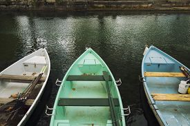 stock photo of annecy  - Detail of colourful rowing boats with oars - JPG