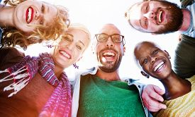 picture of huddle  - Friendship Huddle Happiness Beach Summer Concept - JPG