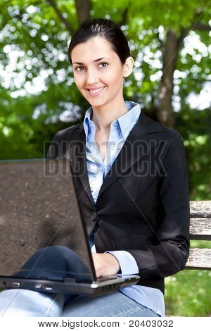 Woman Working On Laptop Outdoor