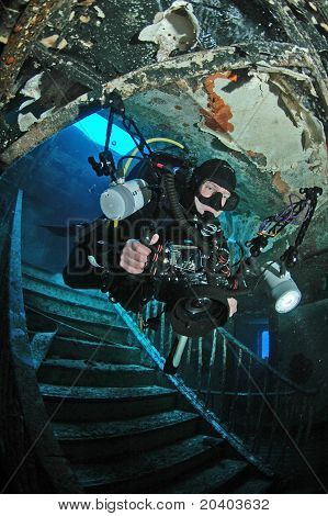 Underwater photographer inside shipwreck