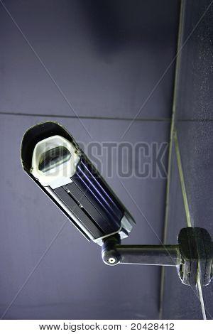 black CCTV security camera on modern wall