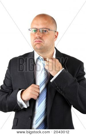 Stressed Businessman Loosening His Tie