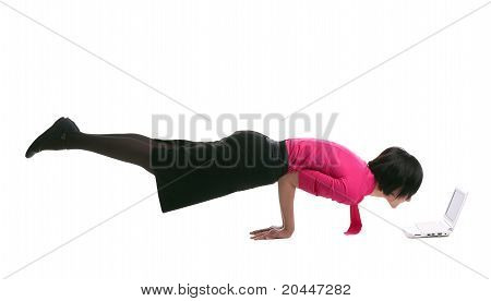 Young business woman lay in yoga pose with laptop