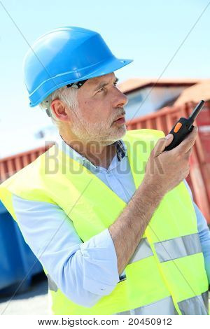 Site manager using walkie-talkie