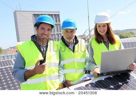 Group of engineers meeting on building roof