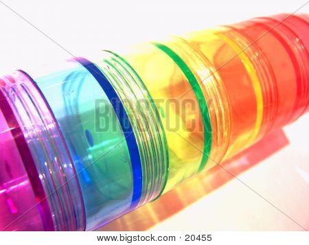 Transportadores de pílula do arco-íris