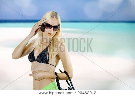 Young Sexy Woman In Summer About Open Water