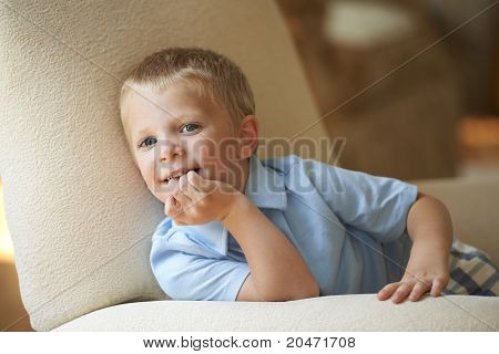 Cute Boy Resting In Chair