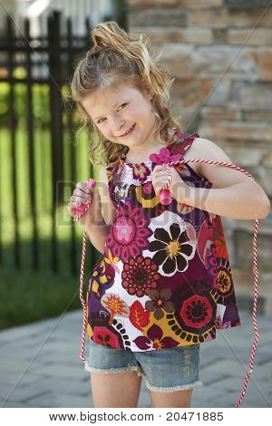 Cute Girl Holding Jumprope