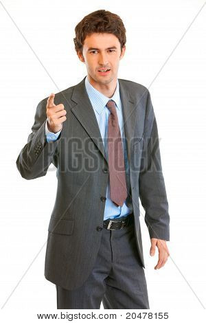 Strict modern businessman shaking his finger isolated on white