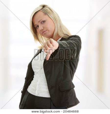 Attractive blonde woman in professional business suit pointing her thumbs down