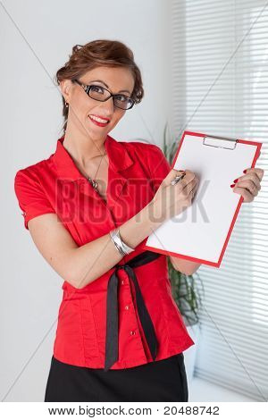 Businesswoman Shows Blank Clipboard.
