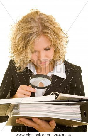 Woman Checking Contract With Magnifying Glass