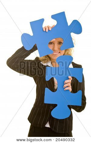 Business Woman Carrying Jigsaw Pieces