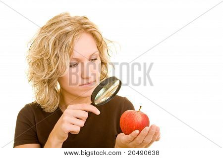 Woman Checking Apple With Magnifying Glass