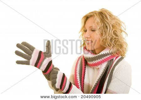 Woman Putting On Gloves