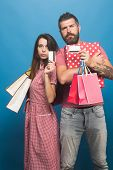 Guy With Beard And Pretty Lady With Serious Faces poster
