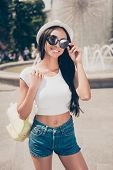 Attractive Carefree Gorgeous Mixed-race Lady With Bronze Skin Is Posing In Sunny Town, On Stroll, In poster