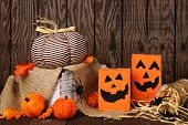 Rustic Shabby Chic Halloween Decor Against An Old Wood Background poster