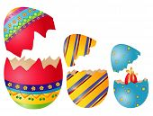 stock photo of easter-eggs  - Three colored open easter eggs with surprise - JPG