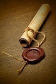 picture of wax seal  - Manuscript with wax seal on a wooden table - JPG