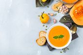 Fall Autumn Roasted Orange Pumpkin Carrot Soup With Garlic poster