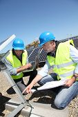 Engineers checking solar panels running