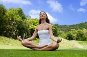 foto of pranayama  - Quiet young woman practicing yoga - JPG