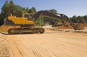 picture of exhumed  - An industrial excavator at a construction site - JPG