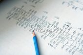 stock photo of electrical engineering  - Electrical schemes on document with pen used for power industry - JPG