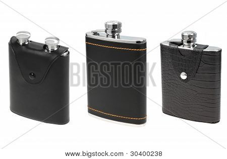 Three Black Leather Flasks For Alcohol Isolated On White