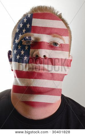 Face Of Serious Patriot Man Painted In Colors Of America Flag