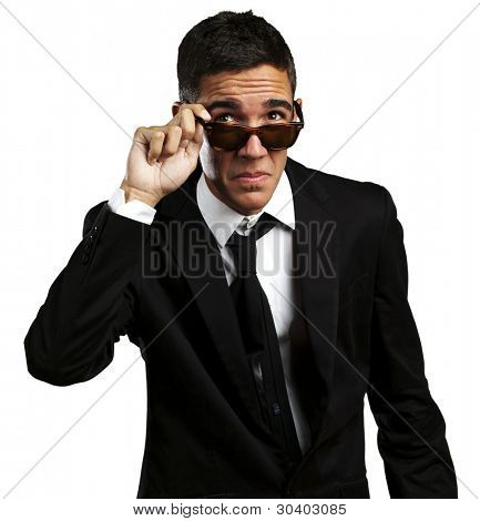 portrait of business man taking off the sunglasses against a white background