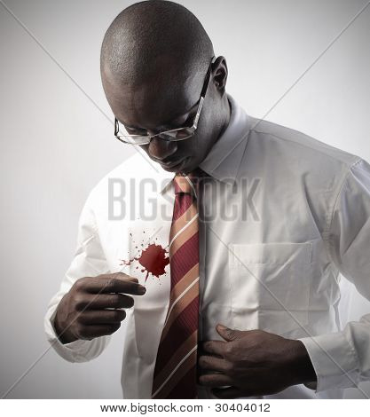 African businessman with a stain on his shirt