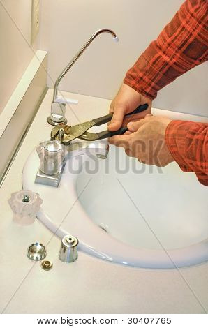 Man fixing leaky faucet