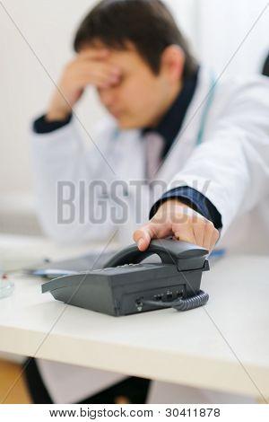 Frustrated Medical Doctor Picking Up Phone Handset