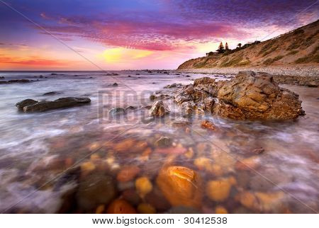 Sunset over rocky beach