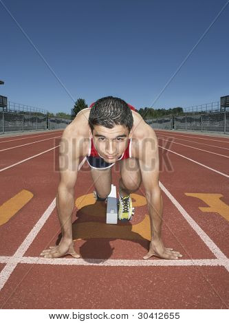 Male track athlete at the starting line