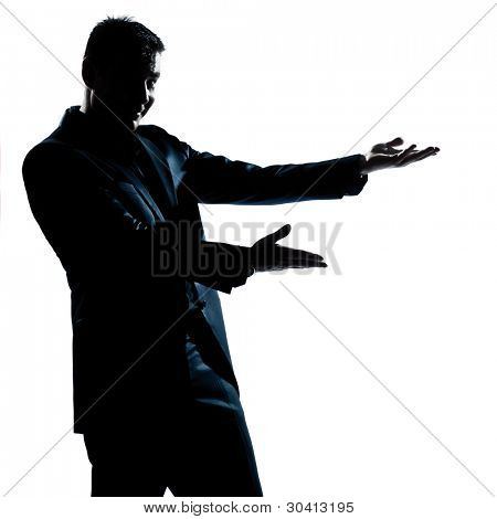 one caucasian man portrait showing pointing empty copy space silhouette in studio isolated white background