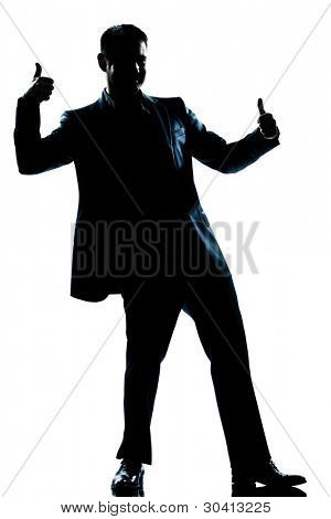 one caucasian man double thumb up full length silhouette in studio isolated white background