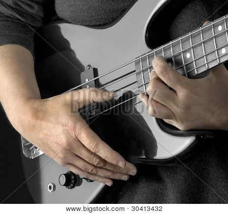 Hand On Bass Guitar