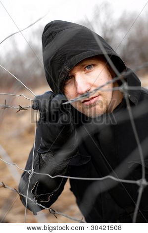 Hooded man outdoor portrait