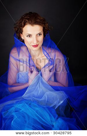Woman With Blue Piece Of Cloth