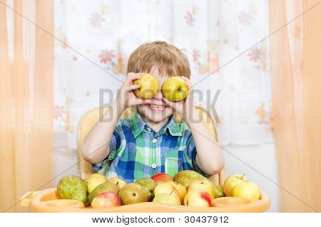 Happy Boy Playing With Apples and fruits