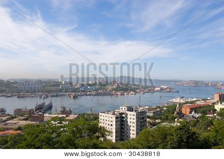 Russia.Bay a Zolotoy Rog(gold horn). Above city smog.September 2006.