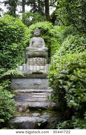 Buddha statue.Garden in Kyoto.Japan.