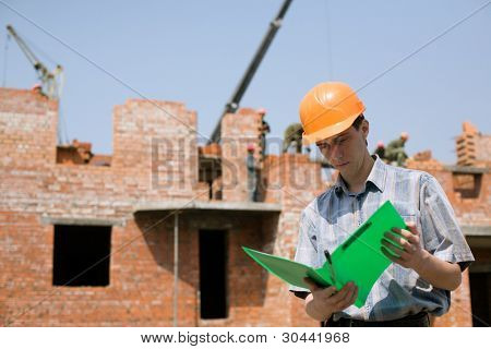 Construction worker.Construction of the house from a brick.